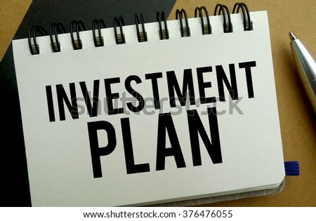 Investment plan memo written on a notebook with pen
