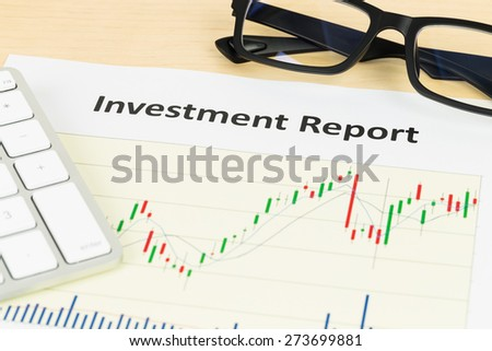 Investment report with keyboard, and glasses - stock photo