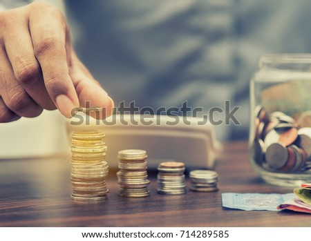 Investor and accountant concept, Saving money and account banking for finance business concept, Business man with stack of coin money on business office table