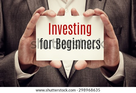 Investor. Business concept. Investing for Beginners card in hands - stock photo