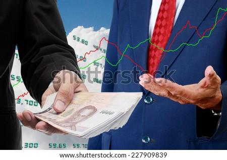 Investor make money from stock exchange concept - stock photo