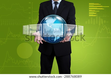Investor with globe on the hands. - stock photo