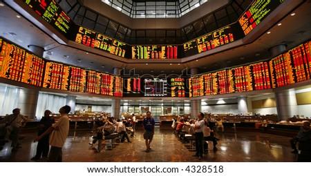 Investors monitor stock market prices. - stock photo