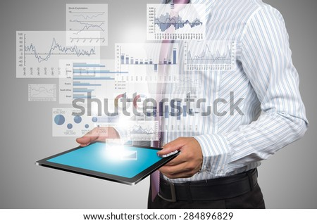 Investors with reported profits on laptop. - stock photo