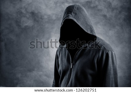 Invisible man in the hood.Background in smoke - stock photo