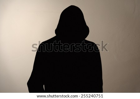 Invisible man in the hood. grey background. - stock photo