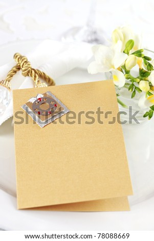 Invitation card for wedding dinner or menu with copy space for text in silver and gold - stock photo