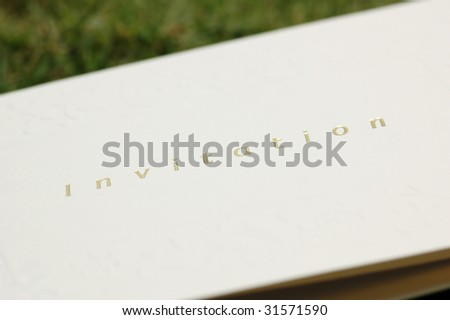 Invitation card with gold hot stamping and embossed patterns - low depth of field
