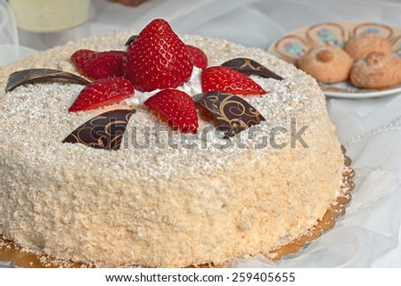 Inviting cake with sponge cake and red strawberries - stock photo