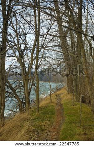 inviting lakeside walking path trail by lake - stock photo