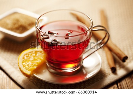 inviting warm spicy drink (toddy or mulled wine) with ingredients