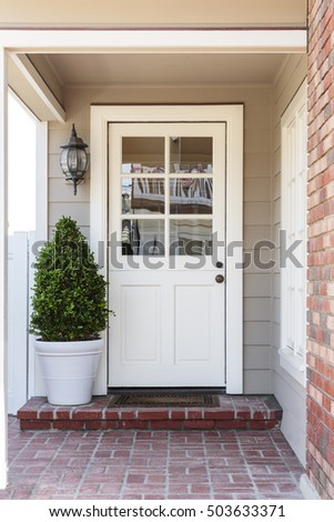 Inviting white front entrance with a front door that is closed