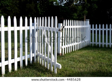 Inviting white picket fence with gate opened welcomes you