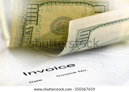 Invoice and dollar bills - stock photo