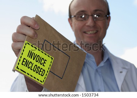 Invoice enclosed ( shallow DOF) - stock photo