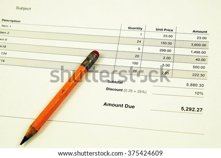 Invoice with vintage pencil