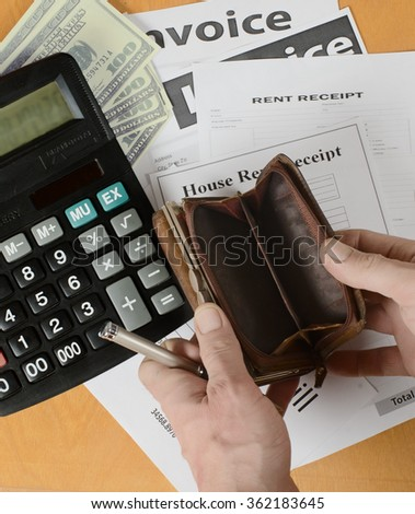 invoices, old leather outdoor purse photographed against the background of a wooden surface