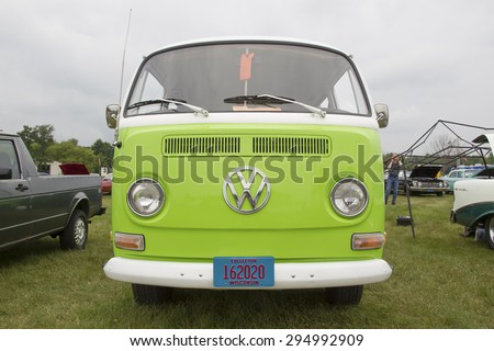 IOLA, WI - JULY 12:  Front of 1971 Volkswagen VW Van Green Car at Iola 42nd Annual Car Show July 12, 2014 in Iola, Wisconsin. - stock photo