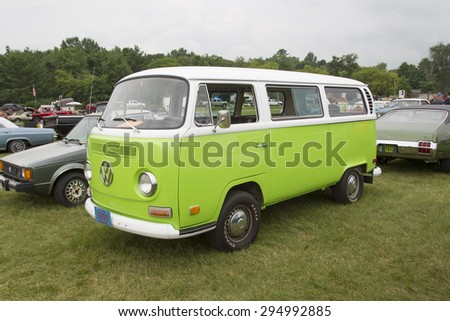 IOLA, WI - JULY 12:  Side of 1971 Volkswagen VW Van Green Car at Iola 42nd Annual Car Show July 12, 2014 in Iola, Wisconsin. - stock photo
