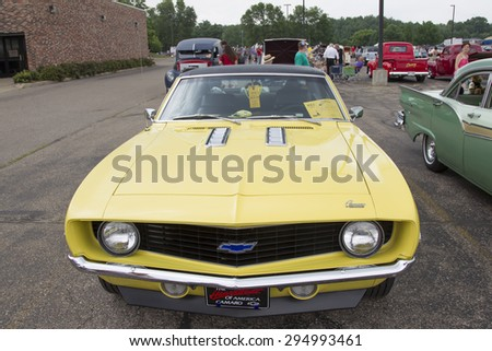 IOLA, WI - JULY 12:  1969 Yellow Chevy Camaro Car at Iola 42nd Annual Car Show July 12, 2014 in Iola, Wisconsin. - stock photo