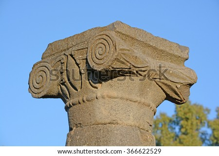 Ionic column capital with scrolling volutes - stock photo