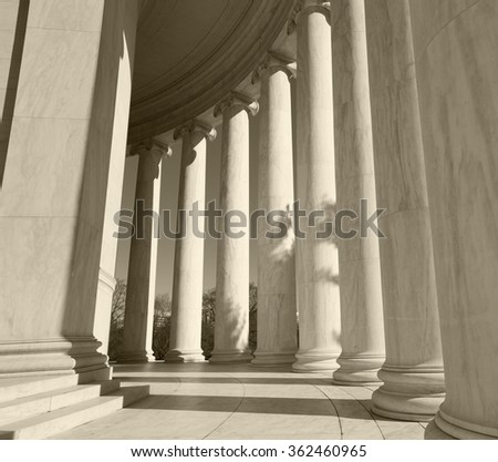 Ionic Columns or pillars warm sepia filter. Welcoming image - stock photo