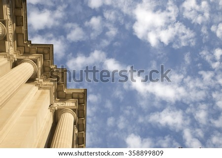Ionic columns rising to the blue sky in Washington DC. Historic Ionic Column architecture in Washington DC. Copy place. - stock photo