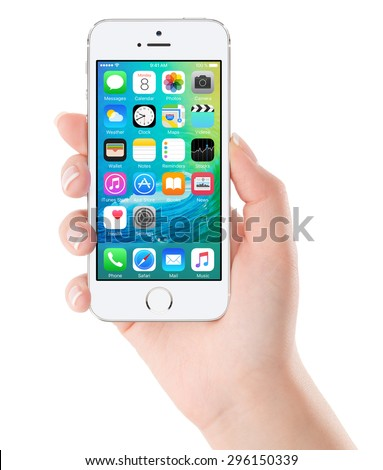 iOS 9 homescreen on the white Apple iPhone 5s display in female hand. iOS 9 is a mobile operating system created and developed by Apple Inc. Isolated on white background. Bulgaria - February 02, 2015. - stock photo