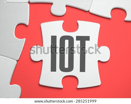 IOT - Internet of Thing - Text on Puzzle on the Place of Missing Pieces. Scarlett Background. Close-up. 3d Illustration. - stock photo