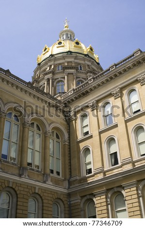 Iowa State Capitol main dome and building up close under blue skies - stock photo