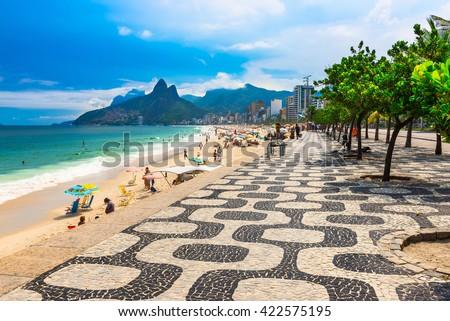 Ipanema beach with mosaic of sidewalk in Rio de Janeiro. Brazil - stock photo
