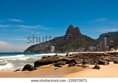 Ipanema Beach with Rocks on Sunny Summer Day, Rio de Janeiro, Brazil - stock photo