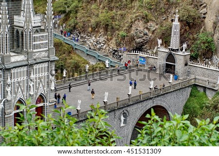 IPIALES, COLOMBIA - CIRCA MARCH 2016: Bridge across the gorge in front of the neo-gothic Las Lajas Sanctuary in a gorge - stock photo