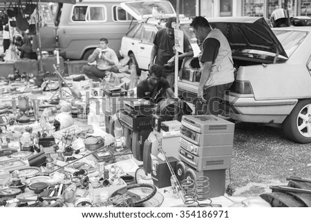 IPOH, PERAK, MALAYSIA - Dec 13, 2015 - A view of seller and product on sales at a weekend flea market in Ipoh, Perak.