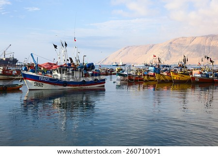 IQUIQUE, CHILE - JANUARY 22, 2015: Fishing boats anchoring in the port of Iquique on January 22, 2015 in Iquique, Chile. Iquique is an important port city in Northern Chile.  - stock photo