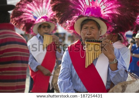 IQUIQUE, CHILE - JANUARY 27, 2012: Indigenous men play the flute during a street performance celebrating their traditions. January 27, 2012 in Iquique, Chile. - stock photo