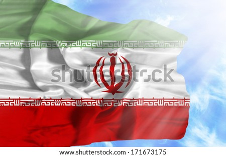 Iran waving flag against blue sky with sunrays - stock photo