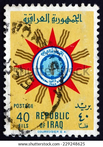 IRAQ - CIRCA 1959: a stamp printed in the Iraq shows Emblem of Republic, circa 1959 - stock photo