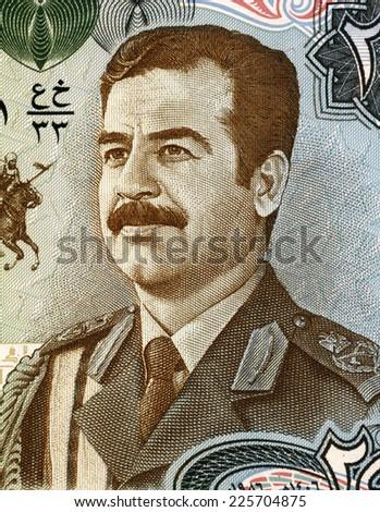 IRAQ - CIRCA 1986: Saddam Hussein (1937-2006) on 25 Dinars 1986 Banknote from Iraq. Fifth President of Iraq during 1979-2003. - stock photo
