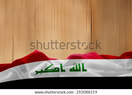 iraq flag and wood background