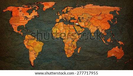 iraq flag on old vintage world map with national borders - stock photo