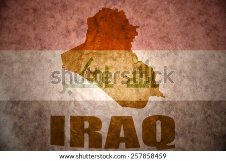 iraq map on a vintage iraqi flag background - stock photo