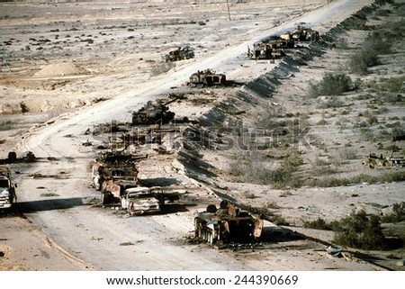 Iraqi armored personnel carriers tanks and trucks destroyed in a Coalition attack along a road in the Euphrates River Valley during Operation Desert Storm. March 4 1991 - stock photo