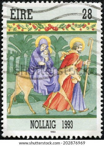 "IRELAND - CIRCA 1993: A stamp printed in Ireland from the ""Christmas "" issue shows The flight into Egypt, circa 1993. - stock photo"