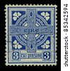 IRELAND-CIRCA 1922: A stamp printed in IRELAND shows image of Celtic cross  is a symbol that combines a cross with a ring surrounding the intersection, circa 1922. - stock photo