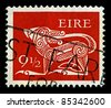 """IRELAND-CIRCA 1979: A stamp printed in IRELAND shows image of """"Dog"""" part of an old Irish decorative brooch, circa 1979. - stock photo"""