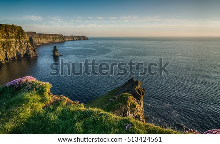 Ireland countryside tourist attraction in County Clare. The Cliffs of Moher West coast of Ireland. Epic Irish Landscape and Seascape along the wild atlantic way. Beautiful scenic nature hdr Ireland.