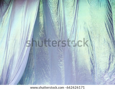 Iridescent White Curtains Ripple And Billow In A Light Breeze Before Being Pulled Down At An