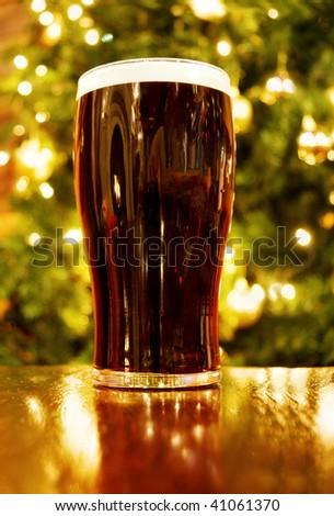 Irish Christmas with pint of black beer - stock photo