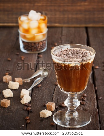 Irish Coffee with coffee beans, whiskey and cream - stock photo